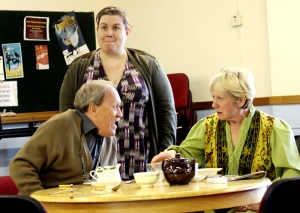 Pictured in rehearsal: a breakfast scene dispute between Michael (Chris Bissex-Williams) and Charlotte (Sue Morgan) while Belle (Karen Davies) looks on. (PHOTO: PHIL MANSELL)